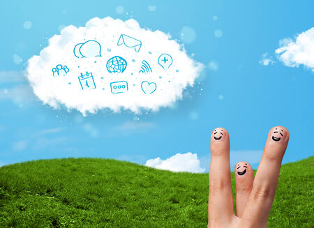 Happy cheerful smiley fingers looking at cloud with blue social icons and smybols photo