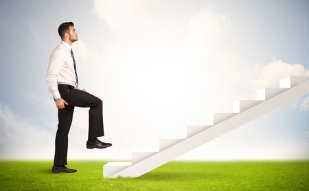 Business person climbing up on white staircase in nature background concept photo