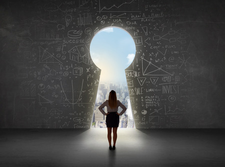Business woman looking at keyhole with bright cityscape concept background