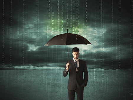 Business man standing with umbrella data protection concept\ on background
