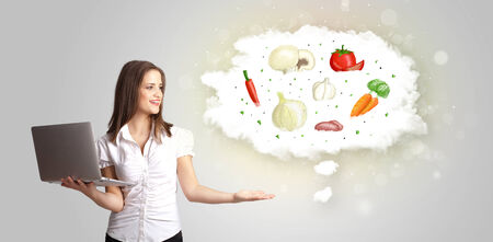 eating food: Pretty woman presenting a cloud of healthy nutritional vegetables concept Stock Photo