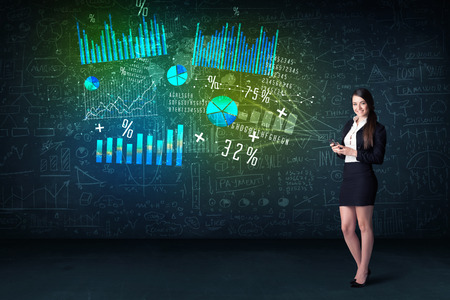 Businesswoman in office with tablet in hand and high tech graph charts concept on background Stock Photo