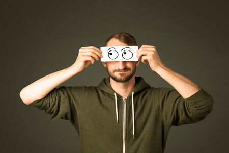Silly man looking with hand drawn eye balls on paper Stock Photo
