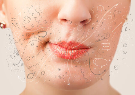 mouth close up: Pretty woman mouth blowing hand drawn icons and symbols close up Stock Photo