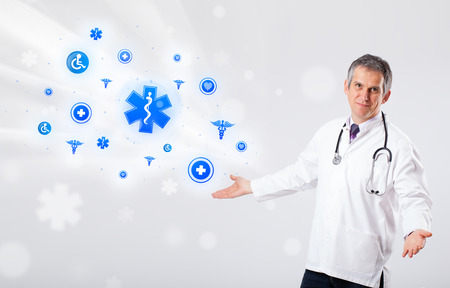 icone: Middle aged doctor with blue medical icons Stock Photo