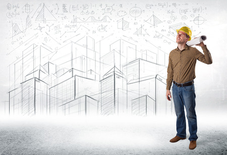 Handsome construction specialist with city drawing in background concept photo