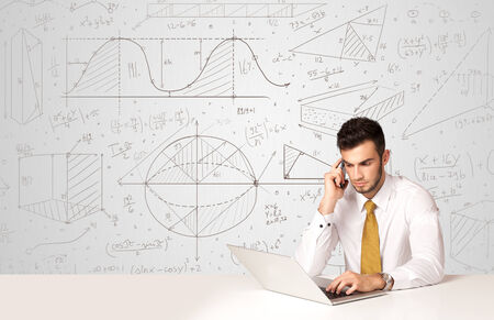 Business man sitting at white table with hand drawn calculations background photo