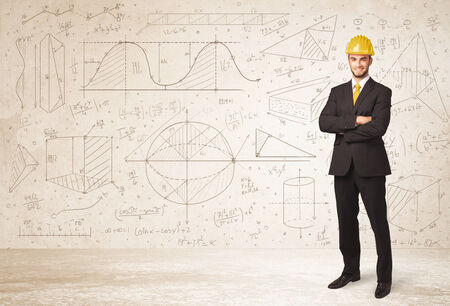 Handsome engineer calculating with hand drawn background concept photo