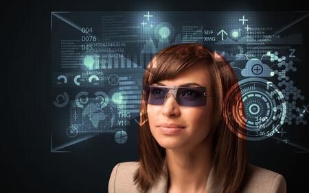 Young woman looking with futuristic smart high tech glasses concept photo