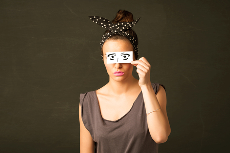 Silly youngster looking with hand drawn eye paper concept photo