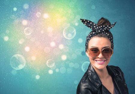 Young woman with sunglasses and bokeh colourful lights concept photo
