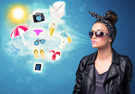 Happy joyful woman with sunglasses looking at summer icons and symbols concept photo