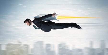 jetpack: Superhero business man flying with jet pack rocket above the city concept Stock Photo