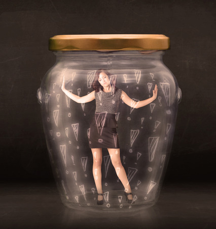 suffocating: Business woman trapped in jar with exclamation marks concept on bakcground