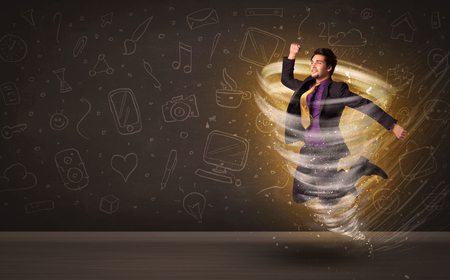 businessman jumping: Happy businessman jumping in tornado concept on brown background