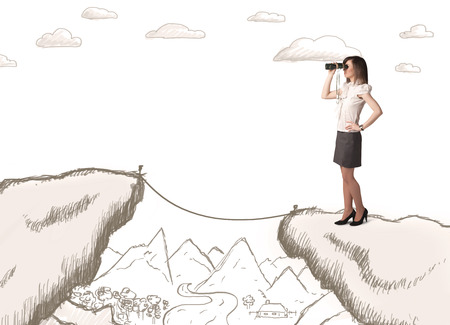 Businesswoman standing on the hand drawn edge of mountain
