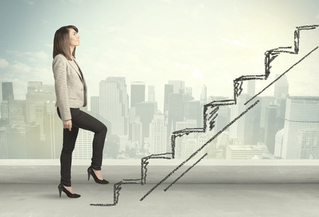Business woman climbing up on hand drawn staircase concept on city background 스톡 콘텐츠