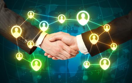 business handshake: Business handshake, social netwok concept