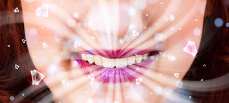 mouth close up: Beautiful girl mouth breathing abstract white lights and crystals close up Stock Photo