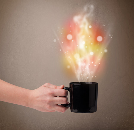 cofe: Coffee mug with abstract steam and colorful lights, close up Stock Photo