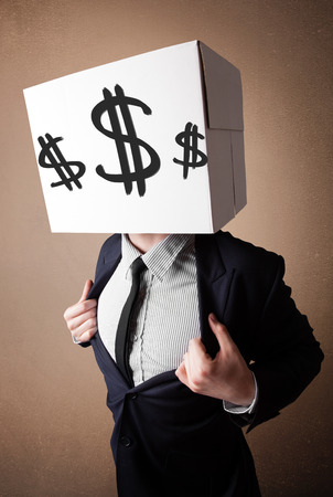 Businessman standing and gesturing with a cardboard box on his head with dollar signs photo