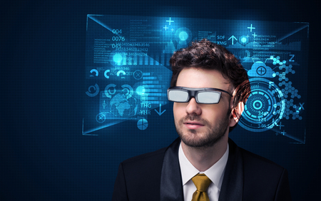Young man looking with futuristic smart high tech glasses concept photo