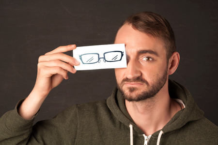 Happy guy looking with paper hand drawn eye glasses concept photo