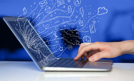 Man pressing notebook laptop computer with doodle icon media cloud symbols photo