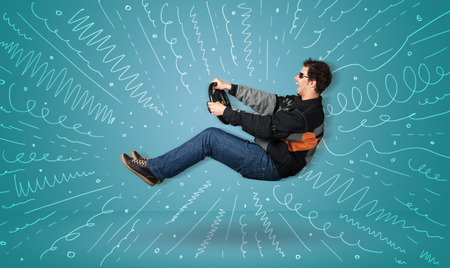 ridiculous: Funny guy drives an imaginary vehicle with drawn lines around him concept Stock Photo