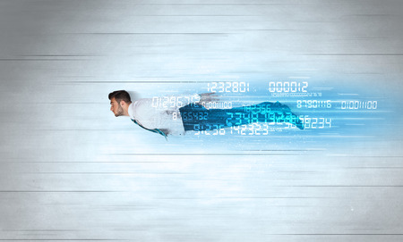 Businessman flying super fast with data numbers left behind concept photo