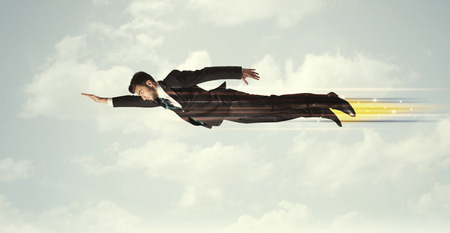 Happy business man flying fast on the sky between clouds concept photo