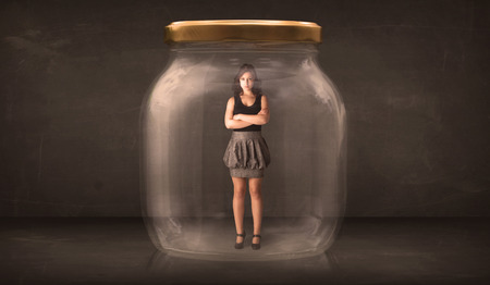 suffocating: Businesswoman captured in a glass jar concept concept on background