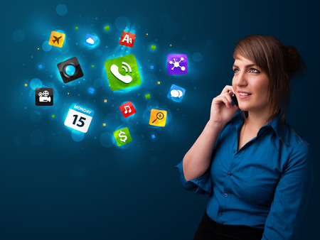 Attractive young woman calling by phone with various icons photo