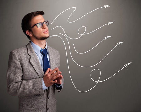 theorize: Attractive young man looking at multiple curly arrows