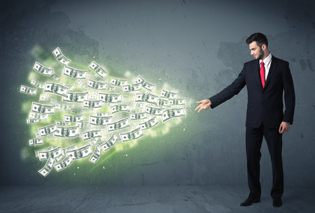 trading floor: Business person throwing a lot of dollar bills concept on background