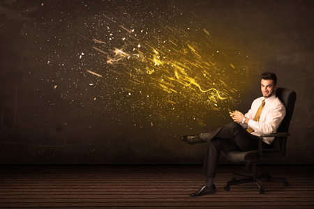 Businessman with tablet and energy explosion on background concept photo