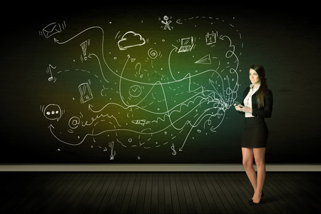 Businesswoman sitting in chair holding tablet with media icons concept on background photo