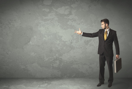 Business person throwing with empty copyspace in a room photo