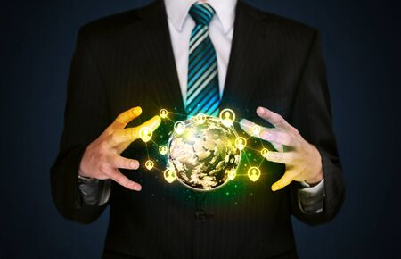 Businessman holding a shining globe with social media connection photo