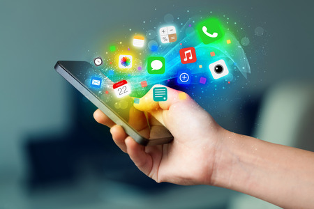 smartphone apps: Hand holding smartphone with colorful app icons concept Stock Photo