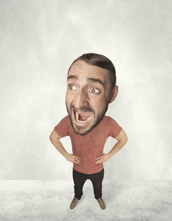 Funny person with big head makes jesting facial expression photo
