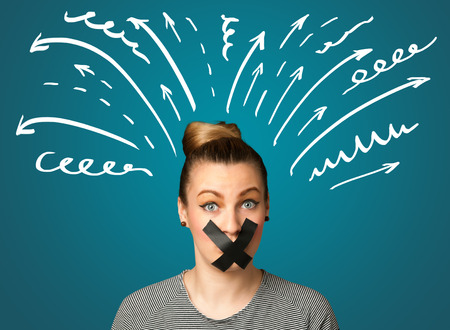 dismay: Young woman with taped mouth and white drawn lines and arrows around her head