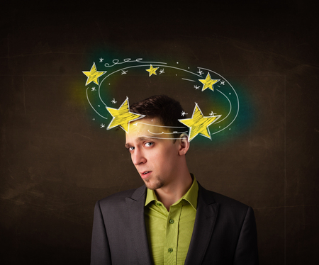 Young man with yellow stars circleing around his head illustration Stock Photo