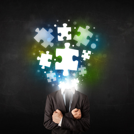 business focus: Character in suit with glowing puzzle head concept