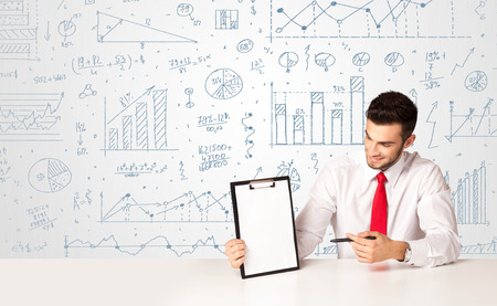 Businessman sitting at white table with hand drawn diagram background photo
