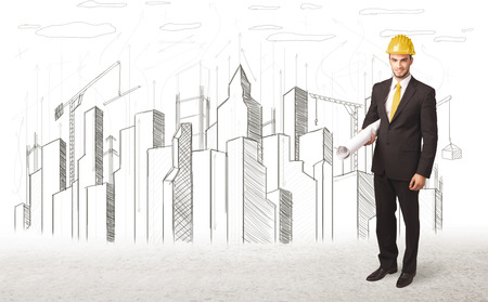 Engineer man with building city drawing  photo
