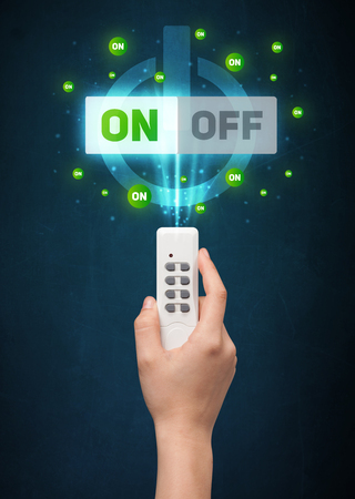 out of control: Hand holding a remote control, on-off signal coming out of it