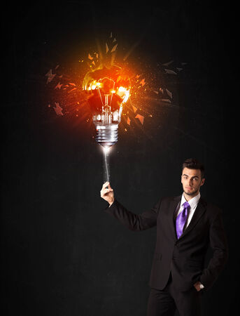 smithereens: Businessman with an explosion bulb on black