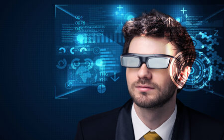futuristic man: Young man looking with futuristic smart high tech glasses concept