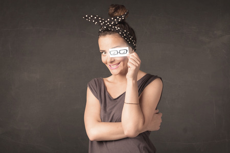 Happy girl looking with hand drawn eye glasses paper concept photo